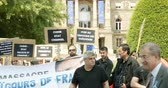 parlament : STRASBOURG, FRANCE - JULY 11, 2015: Uyghur human rights activists participate in a demonstration to protest against Chinese governments policy in Uyghur