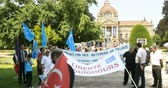 european court of human rights : STRASBOURG, FRANCE - JULY 11, 2015: Freedom to Uyghur - human rights activists participate in a demonstration to protest against Chinese governments policy in Uyghur