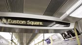 разрыв : This is Euston Station signage on the digital display with the announcement of the King Cross Station in London Underground
