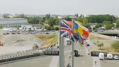 kurum : STRASBOURG, FRANCE - CIRCA 2017: European Union flags waving on the parvis of the European Parliament in Strasbourg - unique footage view from inside the building at the United Kingdom flag Brexit footage Stok Video