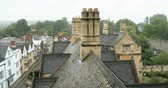 построен структуры : Aerial view over rainy Oxford roofs from the windows of the New College - Oxford university footage. Стоковые видеозаписи