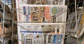 newspaper stack : PARIS, FRANCE - CIRCA 2017: Russian, Turkish, Italian and other French press newspaper from a newsstand featuring headlines with international news