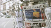 donald trump : PARIS, FRANCE - JUN 12, 2017: City press kiosk with Die Zeit at press kiosk German newspaper with Trump and Nazi message on the Bild magazine slow motion
