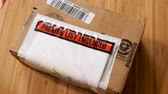 parcels : Packaging list enclose man unboxing cardboard box received by post after an online purchase experience