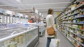 musli : PARIS, FRANCE - CIRCA 2017: Supermarket scene with woman walking between rows of supermarket searching for the bio organic products made by European and American manufacturers