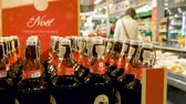 mercearia : PARIS, FRANCE - CRICA 2017: Fisher Christmas beer bottles in modern supermarket. The Fischer brewery was founded in 1821 in Strasbourg, in the Alsace region in France, and moved to Schiltigheim in 1854, because of the water quality there