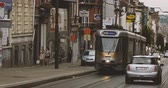 tram : BRUSSELS, BELGIUM - CIRCA 2017: Tramway number 81 with destination Montgomery stop at the red light - rush hour on Brussels streets with cars and commuters Stock Footage