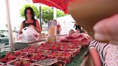 grande grupo de objetos : Strasbourg, France - circa 2017: Farmers selling to customers strawberries at the traditional French farmer market in Strasbourg - buying Alsace cherries organic bio food
