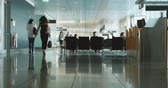 family business : MUNICH, GERMANY - CIRCA 2017 German International Airport commuters people time-lapse motion of commuters waiting for the delayed airplane in German International airport of Munchen