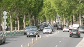 french street : Paris, France - Circa 2017: View from above of the New York Avenue in Paris heavy traffic transportation commuting, next to the Flamme de la Liberty - unofficial Princess Diana monument