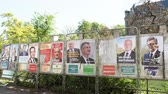 melenchon : STRASBOURG, FRANCE - APR 23, 2017: French presidential posters for the upcoming presidential election in France, in front of the City Hall building in Strasbourg Stock Footage