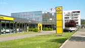 adam : STRASBOURG, FRANCE - CIRCA 2017, Point of view of walking fast nearby the Opel car dealership representative auto saloon - building with cars inside and Opel Logotype Stok Video