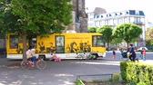 céus : STRASBOURG, FRNACE - CIRCA 2017: Mediatheques CUS yellow bibliotheque library bus parked on a central square in Strasbourg offering books for kids and adults on a Saturday morning education on wheels Stock Footage