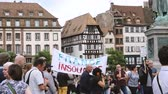 megafon : STRASBOURG, FRANCE - JUL 12, 2017: France Insoumise placard at protest Place General Kleber against Macron government spending cuts and pro-business tax and labor reforms