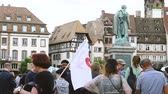 protesters : STRASBOURG, FRANCE - JUL 12, 2017: Phi sign on flag - Protesters in Place Kleber as Melenchon called for day of protest against Macron government spending cuts and pro-business tax and labor reforms Stock Footage
