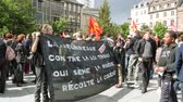 strike : STRASBOURG, FRANCE - SEPT 12, 2017: Young people with placard at political march during a French Nationwide day of protest against the labor reform proposed by Emmanuel Macron Government Stock Footage