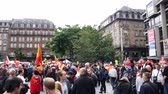 macron government : STRASBOURG, FRANCE - SEPT 12, 2017: Demonstrators gathering Place Kleber at political march during a French Nationwide day of protest against the labor reform proposed by Emmanuel Macron Government