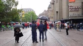 demonstrators : STRASBOURG, FRANCE - SEPT 12, 2017: Police under rain surveillance of people at political march during a French Nationwide day of protest against the labor reform proposed by Emmanuel Macron Government Stock Footage