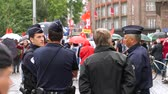 forradalom : STRASBOURG, FRANCE - SEPT 12, 2017: Police under rain surveillance of people at political march during a French Nationwide day of protest against the labor reform proposed by Emmanuel Macron Government Stock mozgókép