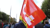 french communist party : STRASBOURG, FRANCE - SEPT 12, 2017: General Confederation of Labour flags at political march during a French Nationwide day of protest against the labor reform proposed by Emmanuel Macron Government