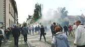 forradalom : STRASBOURG, FRANCE - SEPT 12, 2017: Smoke grenade in slow motion protest demonstrators during a French Nationwide day of protest against labor reform proposed  Emmanuel Macron Stock mozgókép