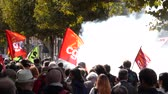 macron government : STRASBOURG, FRANCE - SEPT 12, 2017: Crowd walking with smoke grenade protest demonstrators during a French Nationwide day of protest against labor reform proposed Emmanuel Macron
