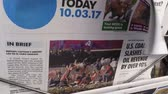 gazetecilik : PARIS, FRANCE - OCT 3, 2017: Man buying USA Today newspaper with socking title and photo at press kiosk about the 2017 Las Vegas Strip shooting in United States with about 60 fatalities and 527 injuries Stok Video