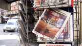 mandalay bay : PARIS, FRANCE - OCT 3, 2017: Liberation French newspaper with socking title and photo at press kiosk about the 2017 Las Vegas Strip shooting in United States with about 60 fatalities and 527 injuries Stock Footage