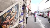lone gunman : PARIS, FRANCE - OCT 3, 2017: Pedestrians near the Times newspaper with socking title and photo at press kiosk about the 2017 Las Vegas Strip shooting in United States slow-motion city news