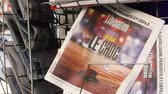 lone gunman : PARIS, FRANCE - OCT 3, 2017: Zoom out from Liberation French newspaper with socking title and photo at press kiosk about the 2017 Las Vegas Strip shooting in United States slow motion Stock Footage