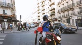 olympiáda : Paris, France - Circa 2017: Sport fan male on motorcycle preparing to wear the French tricolor flag for a major sport event.  Paris is the capital to host the Olympic games 2024 Dostupné videozáznamy