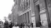 gare : Paris, France - Circa 2016: Majestic old Gare Du Nord Railway station central Paris French architecture, people walking on summer evening - visiting capital of 2024 Olympic games black and white Stock Footage