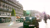 gare : Paris, France - Circa 2016: Car parking in Paris street next to cafe bar restaurants cuisine French at evening with beautiful sunlight flare next to Gare Du Nord - visiting capital of 2024 Olympic games Stock Footage