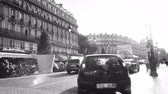 gare : Paris, France - Circa 2016: Car parking in Paris street next to cafe bar restaurants cuisine French at evening with beautiful sunlight flare next to Gare Du Nord - hotel capital of 2024 Olympic games black and white Stock Footage