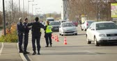 extremism : STRASBOURG, FRANCE - NOV 14 2015: French Police car  and officers checking vehicles on the border between Strasbourg and Kehl Germany, as a security measure in the wake of attacks in Paris