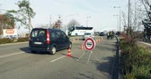 extremism : STRASBOURG, FRANCE - NOV 14 2015: slow down sign with French German Police checking vehicles on the border between Strasbourg and Kehl Germany, as a security measure in the wake of attacks in Paris Stock Footage