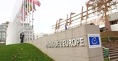symbol of respect : STRASBOURG, FRANCE - 14 Nov 2015: Workers of Council of Europe put all European Union Flags at half-mast in front of the Council of Europe following terrorist attack in Paris at Bataclan