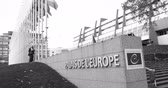symbol of respect : STRASBOURG, FRANCE - 14 Nov 2015: Workers of Council of Europe put all European Union Flags at half-mast in front of Council of Europe following terrorist attack in Paris at Bataclan black and white