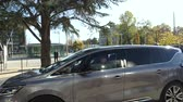 liderlik : STRASBOURG, FRANCE - OCT 31, 2017: Renault Espace Initiale van leaving with Emmanuel Macron French President during official visit at the European Court of Human Rights in Strasbourg Stok Video