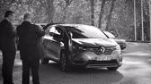 officials : STRASBOURG, FRANCE - OCT 31, 2017: Renault Espace Initiale van car, official transportation of Emmanuel Macron French President parked in front of Council of Europe during official visit b&w