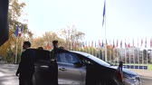 renault : STRASBOURG, FRANCE - OCT 31, 2017: Arrival of the French President Emmanuel Macron at Council of Europe and European Court of Human Rights in Strasbourg - exit the Renault Espace Initiale car Stock Footage