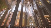 art noveau : BARCELONA, SPAIN - CIRCA 2017: Ultra wide lens inside of Sagrada Familia Church built by Antoni Gaudi - international tourists taking photos selfies with the magnificent religious architecture