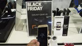 vitrin : PARIS, FRANCE - CIRCA 2017: POV point of view of male buying Samsung Galaxy Android smartphone with special offer during Black Friday inside FNAC French technology retail store Stok Video
