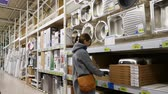 faucet : MARSEILLE, FRANCE - CIRCA 2017: Single woman shopping buying for new sanitary furniture for the bathroom and kitchen - choosing between ceramic, stainless steel sink Stock Footage