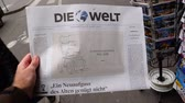 siyaset : PARIS, FRANCE - MAR 15, 2018: German Die Welt newspaper with caricature of Stephen Hawking wheelchair of the English theoretical physicist, cosmologist dead on 14 March 2018
