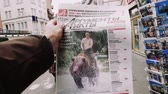 buy press : PARIS, FRANCE - MAR 15, 2018: Argumenty i Fakty Russian newspaper featuring the photograph of Vladimir Putin on a Siberian grizzly bear before Russian Elections