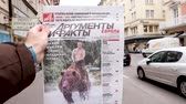 buy press : PARIS, FRANCE - MAR 15, 2018: Argumenty i Fakty Russian newspaper featuring the photograph of Vladimir Putin on a Siberian grizzly bear before Russian Elections slow motion