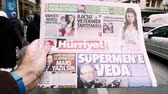 físico : PARIS, FRANCE - MAR 15, 2018: Turkish Hurriyet newspaper with portrait of Stephen Hawking the English theoretical physicist, cosmologist dead on 14 March 2018 outdoor press kiosk cinematic  slow motion