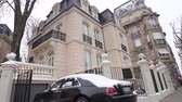 rolls royce : STRASBOURG, FRANCE - CIRCA 2018: Luxury Rolls-Royce Ghost parked in front of expensive French real estate house in central of French city - car covered with snow