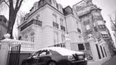 limousine : STRASBOURG, FRANCE - CIRCA 2018: Luxury Rolls-Royce Ghost parked in front of expensive French real estate house in central of French city - car covered with snow - black and white